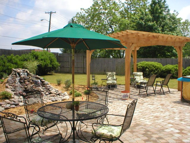 Tulsa Landscape umbrella and cedar arbor pergola