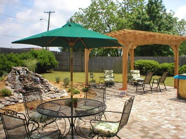 Tulsa Landscape umbrella and cedar arbor pergola