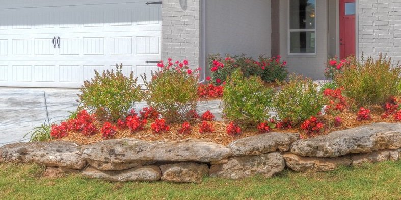 Banner Stacked Limestone boulders by Tulsa Landscape